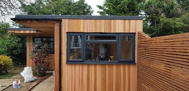 Purley bifold door installation in garden building